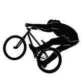 Teenager riding a BMX bicycle in BW Royalty Free Stock Photo