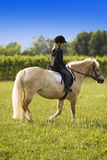 Teenager riding Horse Royalty Free Stock Image