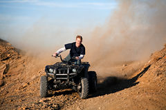 Teenager riding quad four wheeler Stock Photos