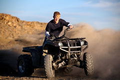 Teenager riding quad four wheeler Royalty Free Stock Images