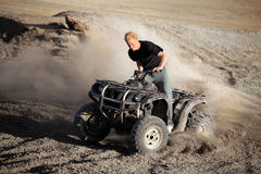 Teenager riding quad - four wheeler Stock Photo