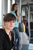 Teenager riding the tram Stock Image