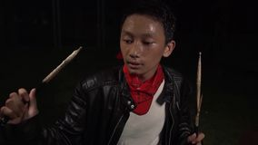 Teenager rock band drummer . cool and talented Asian American mixed young boy playing drums in leather jacket performing song. In dark background feeling super stock video footage