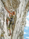 Teenager rock climbing royalty free stock images