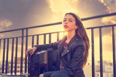 Teenager rock girl sit outdoor at roof terrace royalty free stock image