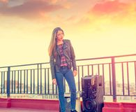 Teenager girl standing outdoor at roof terrace stock image