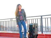 Teenager girl standing outdoor at roof terrace royalty free stock image