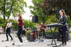 Teenager rock music band performing on the street. Vilnius, Lithuania - May 21, 2016: Teenager rock music band performing on the street in Vilnius, Lithuania Royalty Free Stock Images