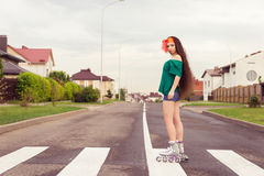 Teenager on roller skates  in street Stock Images