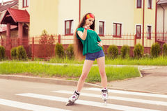 Teenager rollerblading Stock Image
