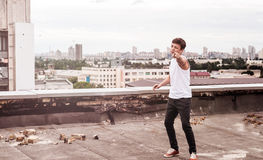 Teenager on the roof of a tall building Royalty Free Stock Photo