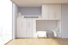 Teenager room with a bunk bed and window. Teenager room interior with a bunk bed and a window. There are white closets above the bed. 3d rendering, mock up Royalty Free Stock Image