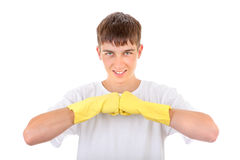 Teenager in Rubber Gloves. Strong Teenager in Yellow Rubber Gloves Isolated On The White Background stock image