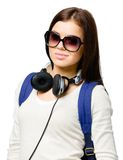 Teenager with rucksack and earphones Royalty Free Stock Image
