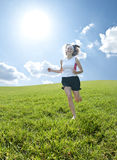 Teenager running through field Royalty Free Stock Image