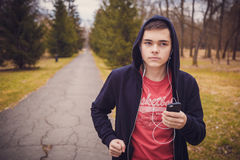 Teenager running in park. Stock Images