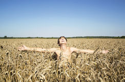 Teenager in the rye field Stock Image