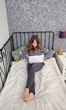 Teenager`s relax with notebook Stock Images