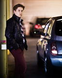 Teenager beside car Stock Photography