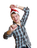 Teenager in a santa hat dancing Royalty Free Stock Photo