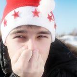 Teenager in Santa Hat. Frozen Teenager in Santa's Hat in the Winter closeup Stock Image