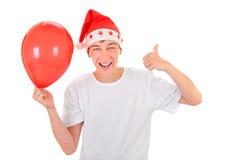 Teenager in Santa Hat Royalty Free Stock Image