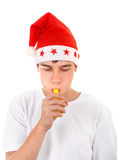 Teenager in Santa Hat Stock Image