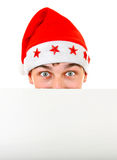 Teenager in Santa Hat. Surprised Teenager in Santa's Hat with Blank Board on the White Background Stock Photo