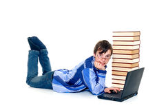 Teenager schoolboy. With laptop books on white background Stock Image