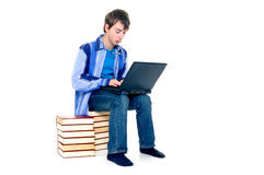 Teenager schoolboy. With laptop books on white background Stock Photo