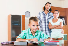 Teenager schoolboy doing homework Royalty Free Stock Images
