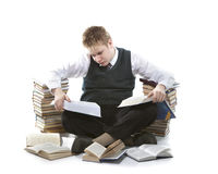 Teenager schoolboy with pile of textbooks Stock Image