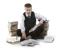 Teenager schoolboy with pile of textbooks Stock Photos