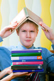 Teenager schoolboy was tired from lessons Stock Photos