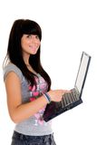 Teenager schoolgirl. With laptop on white background Stock Photography