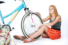 Teenager schoolgirl with her bicycle Royalty Free Stock Image