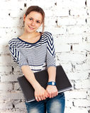 Teenager schoolgirl with laptop Stock Photography