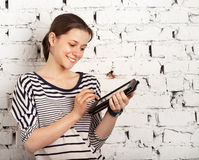 Teenager schoolgirl using tablet computer Royalty Free Stock Photos