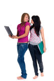 Teenager schoolgirls. With computer and books on white background Stock Image
