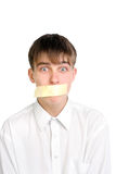 Teenager with sealed mouth Stock Photo