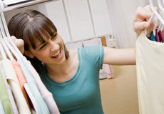 Teenager searching in closet for something to wear Stock Photo