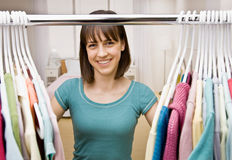 Teenager searching in closet for something to wear stock images