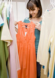 Teenager searching in closet for something to wear Royalty Free Stock Images