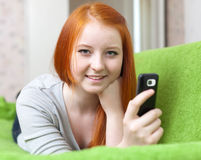 Teenager sends SMS Stock Photo