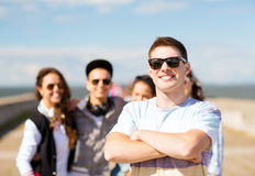 Teenager in shades outside with friends Royalty Free Stock Images