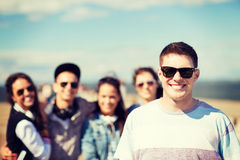 Teenager in shades outside with friends Royalty Free Stock Photography