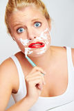 Teenager shaving face Royalty Free Stock Photo