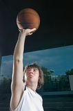 Teenager shooting basketball Stock Image