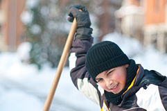 Teenager shoveling snow Royalty Free Stock Photo