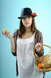 Teenager showing easter basket. Teenager girl with black hat showing egg from easter basket Royalty Free Stock Image